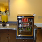 Cold drinks can be found in this small refrigerator throughout the day and evening.