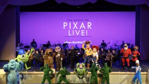 """The Music of Pixar LIVE! A Symphony of Characters"" showcases a selection of unforgettable soundtrack favorites from Disney•Pixar ""Cars,"" ""Finding Nemo,"" ""Monsters, Inc.,"" ""Toy Story"" and ""Up,"" performed by a live orchestra and includes appearances by beloved Disney•Pixar characters like Woody, Buzz and Jessie. This 40-minute concert is presented three times nightly at Theater of the Stars, following regular daily performances of ""Beauty and the Beast – Live on Stage."" (Todd Anderson, photographer)"